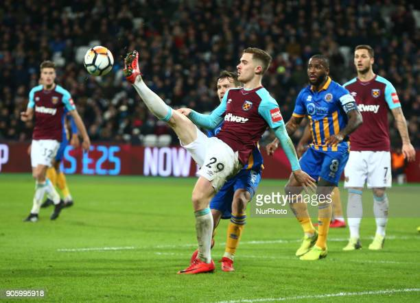 LR West Ham United's Toni Martinez and Shrewsbury Town's Mat Sadler during FA Cup 3rd Round reply match between West Ham United against Shrewsbury...