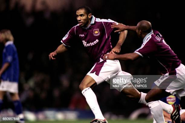 West Ham United's Trevor Sinclair rushes to congratulate Frederic Kanoute on scoring the opening goal against Leicester