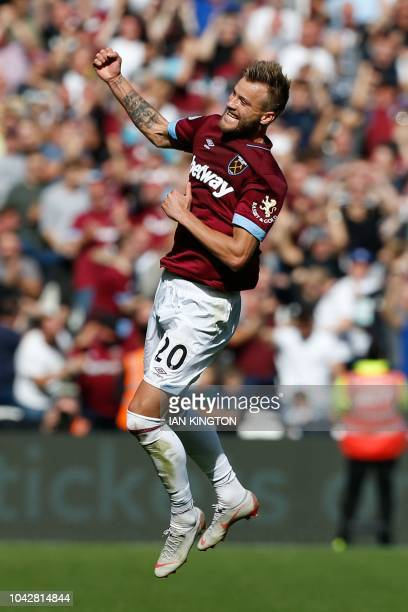 West Ham United's Ukrainian striker Andriy Yarmolenko celebrates after his shot was deflected into the goal off Manchester United's Swedish defender...