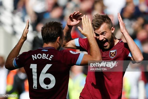 TOPSHOT West Ham United's Ukrainian striker Andriy Yarmolenko celebrates with West Ham United's English midfielder Mark Noble after his shot was...