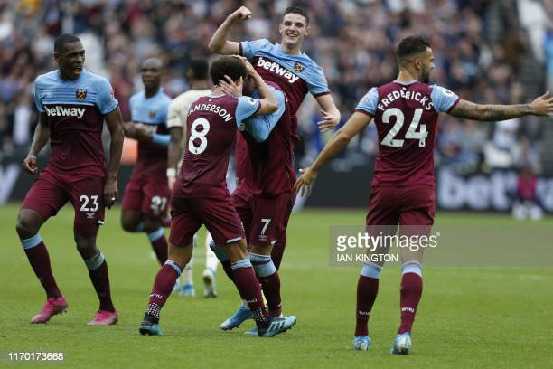 West Ham United's Ukrainian striker Andriy Yarmolenko celebrates with teammates after scoring his team's first goal during the English Premier League...