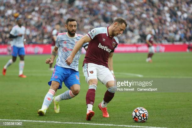 West Ham United's Vladimir Coufal and Manchester United's Bruno Fernandes during the Premier League match between West Ham United and Manchester...