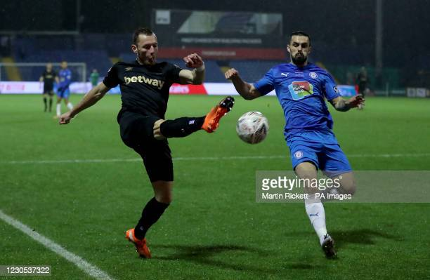 West Ham United's Vladimir Coufal and Stockport County's Jordan Williams battle for the ball during the Emirates FA Cup third round match at Edgeley...