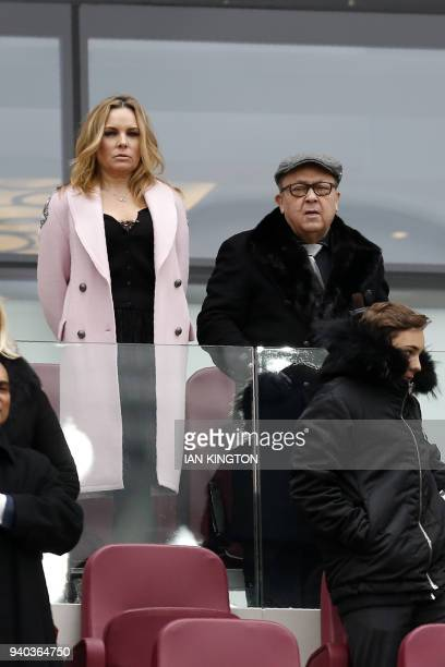 West Ham United's Welsh Chairman David Sullivan and his partner Emma BentonHughes take their seats for the English Premier League football match...