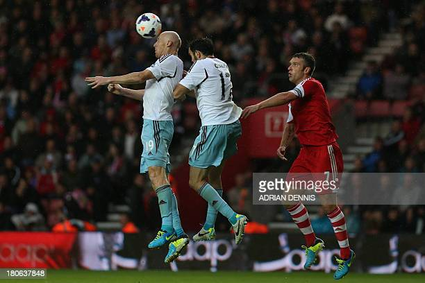 West Ham United's Welsh defender James Collins and West Ham United's Irish defender Joey O'Brien defend a high ball as Southampton's English striker...