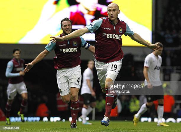 West Ham United's Welsh defender James Collins celebrates scoring their first goal with English midfielder Kevin Nolan during the English FA Cup...
