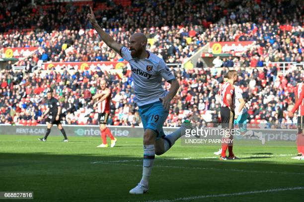 West Ham United's Welsh defender James Collins celebrates scoring West Ham's second goal during the English Premier League football match between...
