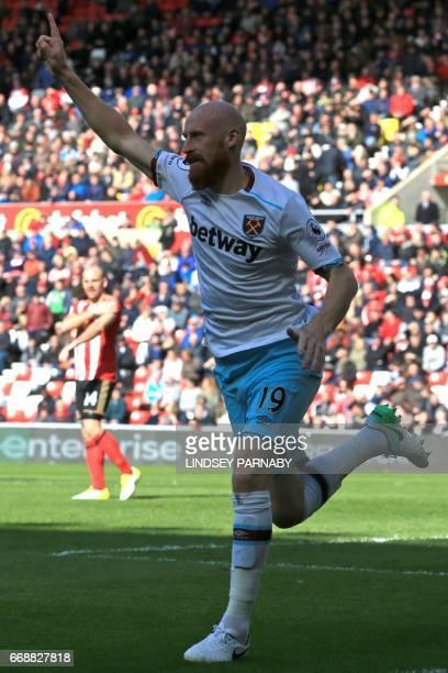 West Ham United's Welsh defender James Collins celebrates scoring West Ham's second goal during the English Premier League football match between...