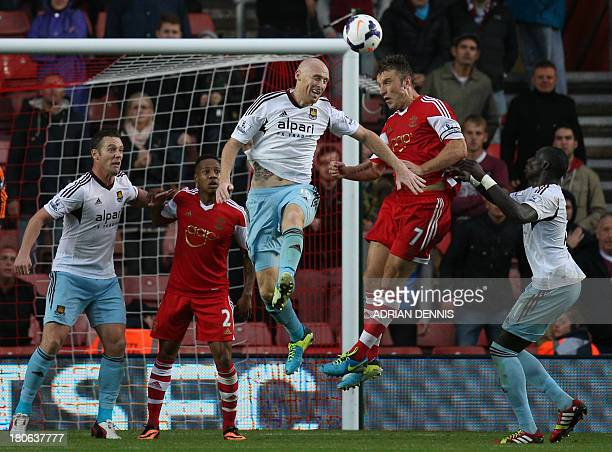 West Ham United's Welsh defender James Collins challenges for a header against Southampton's English striker Rickie Lambert during the English...