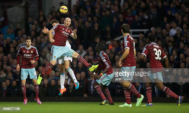 West Ham United's Welsh defender James Collins jumps to win a header during the English Premier League football match between West Ham United and...