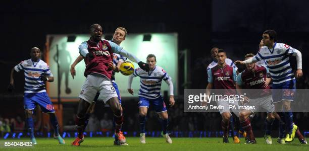 West Ham's Carlton Cole and QPR's Clint Hill compete for possession during the Barclays Premier League match at Upton Park London
