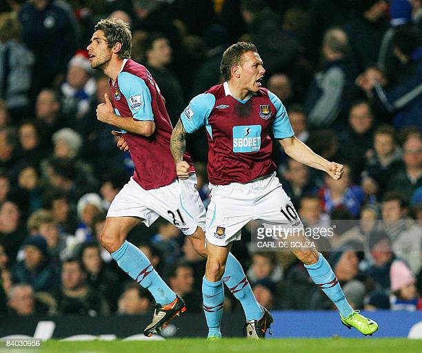 West Ham's Craig Bellamy celebrates with team mate Valon Behrami after scoring the first goal of the match during their premiership match at home to...