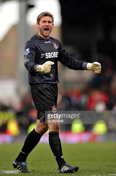 West Ham's English goalkeeper Robert Green celebrates at the final whistle after their 3-1 victory in the English Premier League football match...