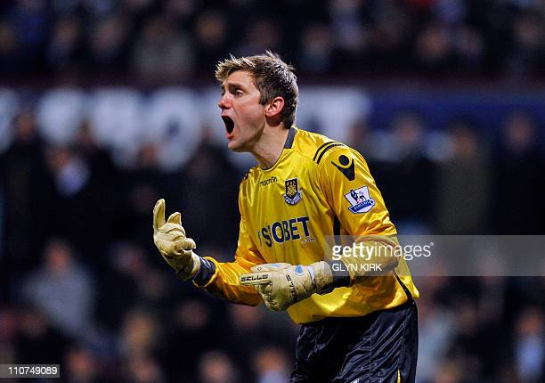West Ham's English goalkeeper Robert Green reacts during their semi final League Cup football match at Upton Park, London, England, on January 11,...