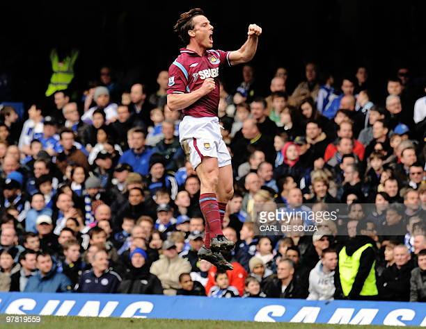 West Ham's English midfielder Scott Parker celebrates after scoring his goal during the English Premier League football match between Chelsea and...