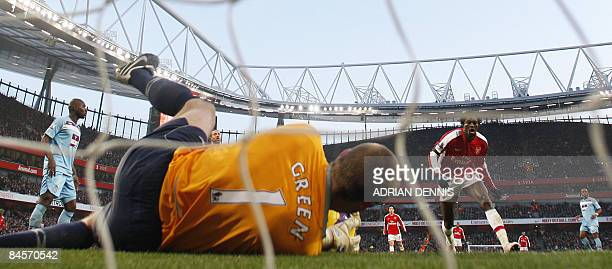 West Ham's goalkeeper Rob Green saves a header from Arsenal's Togolese player Emmanuel Adebayor during the Premiership match at The Emirates Stadium...