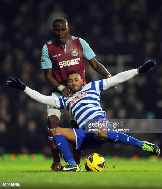 West Ham's Guy Demel challenges QPR's Armand Traore during the Barclays Premier League match at Upton Park London