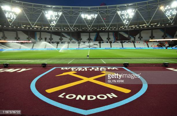 West Ham's logo is pictured next to the pitch ahead of the English Premier League football match between West Ham United and Liverpool at The London...