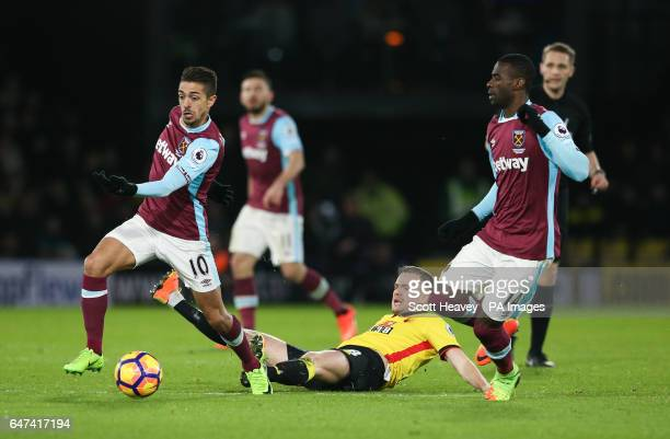 West Ham's Miguel Lanzini and West Ham's Tom Cleverley during the Premier League match at Vicarage Road Watford