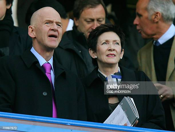 West Ham's new chairman Icelandic business tycoon Eggert Magnusson watches his team play against Chelsea with an unidentified woman during their...