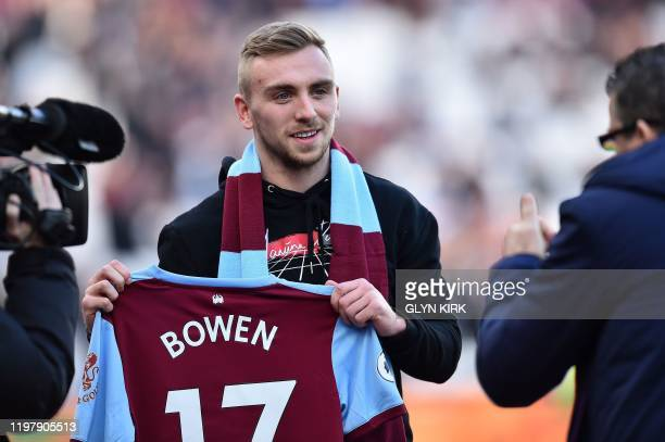 West Ham's new signing English striker Jarrod Bowen is unveiled to fans ahead of the English Premier League football match between West Ham United...