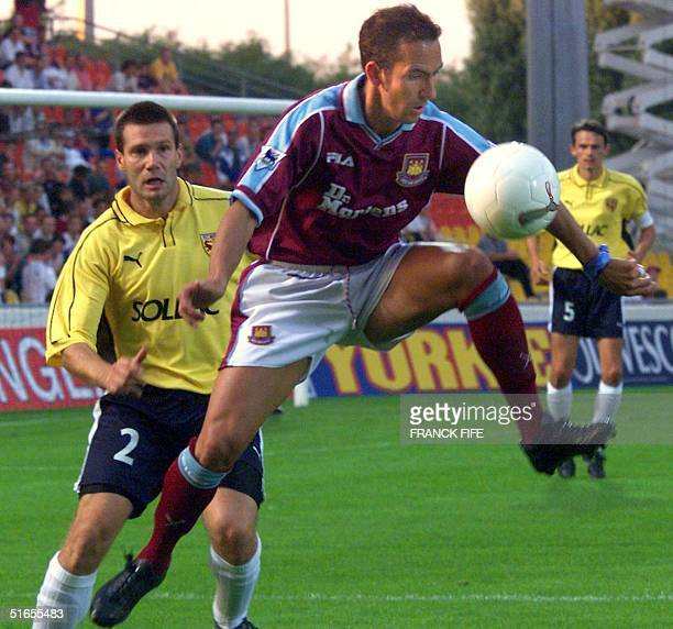 West Ham's Paolo Di Canio controls the ball in the air in front of Metz's Pascal Pierre 24 August 1999 at SaintSymphorien stadium in Metz during...