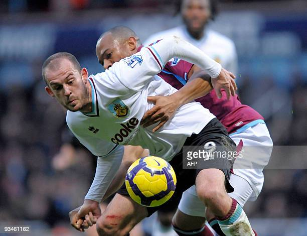 West Ham's Welsh defender Danny Gabbidon vies with Burnley's Scottish player Steven Fletcher during the English Premier League football match between...