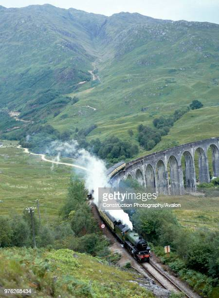 West Highlander No 2005 comes off Glenfinnan viaduct en route from Fort William to Mallaig United Kingdom