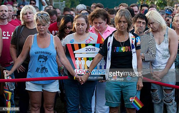 West Hollywood residents observe a moment of silence for victims of a mass shooting at a South Carolina church during a rallyon June 26, 2015 in West...