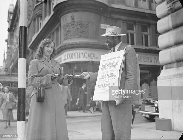 West Indian baritone Edric Conner in Piccadilly to hand out leaflets advertising a West Indian Student Union concert at St Pancras Town Hall 9th...