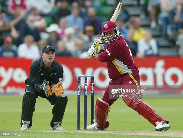 West Indian batsman Ramnaresh Sarwan prepares to cut the ball watched by New Zealand wicketkeeper Gareth Hopkins during the 6th Natwest Series game...