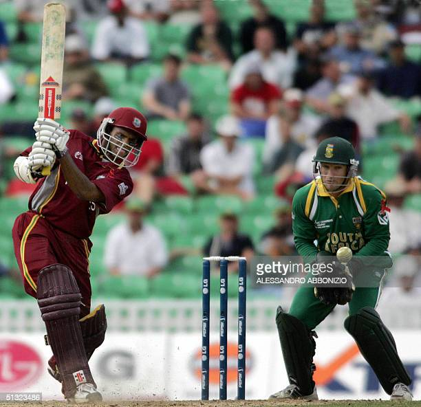 West Indian batsman Shivnarine Chanderpaul drives the ball offside on his way to scoring 51 runs notout against South Africa in the ICC Champions...