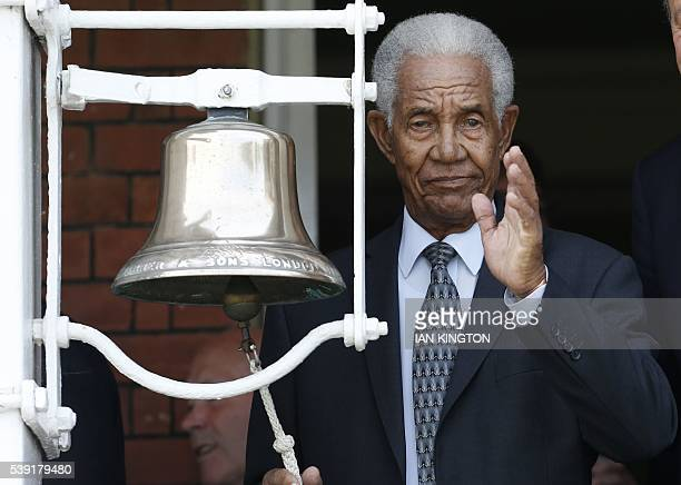 West Indian cricket legend Sir Garfield Sobers waves as he rings the five minute bell before the start of the second session in memory of Muhammad...