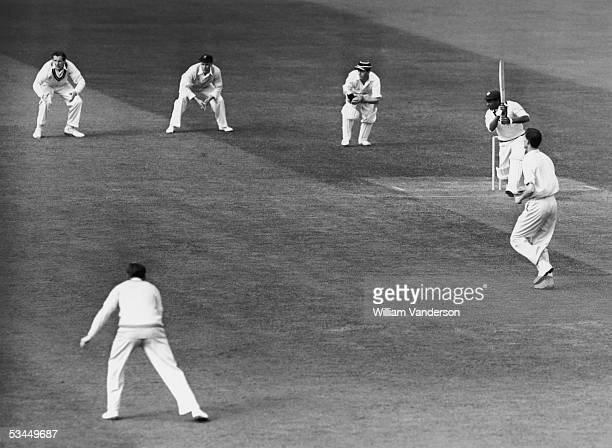 West Indian cricketer Everton Weekes cuts a ball past the slips during a match against Cambridge at Fenners Cricket Ground Cambridge June 1950...