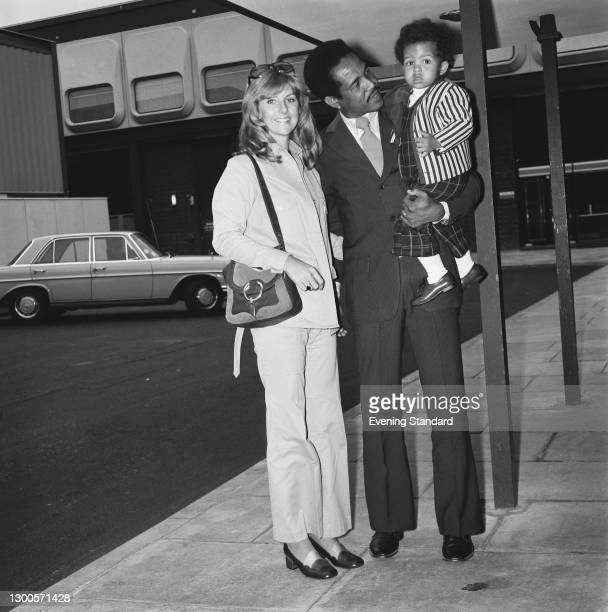 West Indian cricketer Garfield Sobers at Heathrow Airport in London with his wife Prue and their son Matthew, UK, 23rd April 1973. Sobers has arrived...