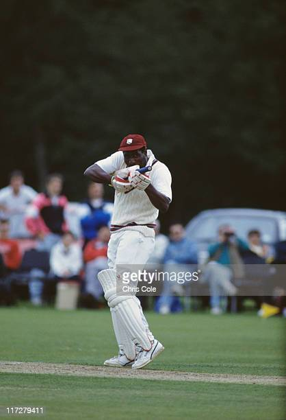 West Indian cricketer Viv Richards pointing with his bat during a match, Brecon, circa 1985.