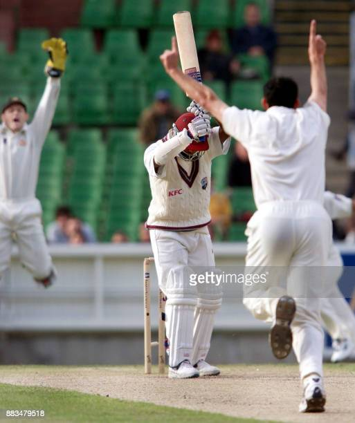 West Indian star batsman Brian Lara is clean bowled by Australian paceman Jason Gillespie without playing a shot as wicketkeeper Adam Gilchrist jumps...