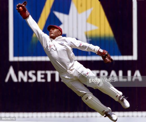 West Indian wicketkeeper Ridley Jacobs dives to catch the ball from an Australian batsman on the third day of the fourth Test match at the MCG in...