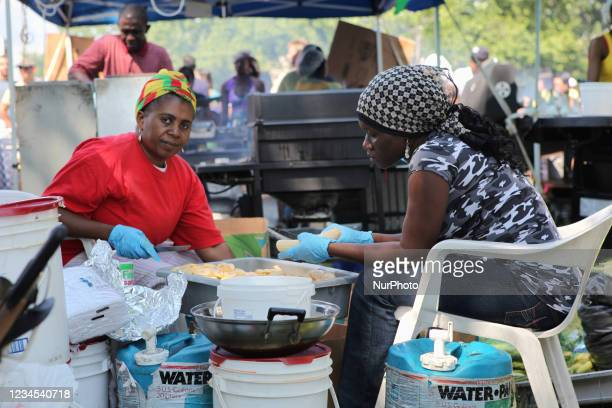 West Indian women cut plantains in preparation to fry them in Toronto, Ontario, Caanda, on August 2009.