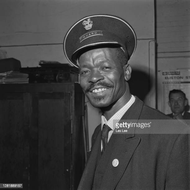 West Indianborn British man Asquith Xavier begins his first day's work as a guard at Euston Station in London becoming the first nonwhite guard at...