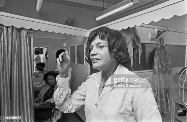 West Indian-born businesswoman and hairdresser Carmen England at her salon in London, UK, 17th August 1973. She went on to co-found the Notting Hill...