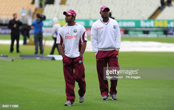 West Indies Adrian Barath and Kirk Edwards walk back to the pavilion after inspecting the outfield during the third Test match at Edgbaston Birmingham