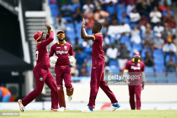 West Indies' Alzarri Joseph celebrates with teammates after dismissing India's Shikhar Dhawan during the fourth One Day International match between...