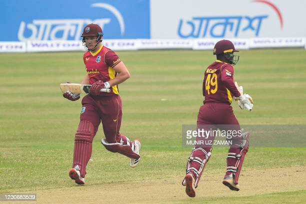 West Indies' Andre McCarthy and his teammate Joshua Da Silva take a run during the first one-day international cricket match between Bangladesh and...