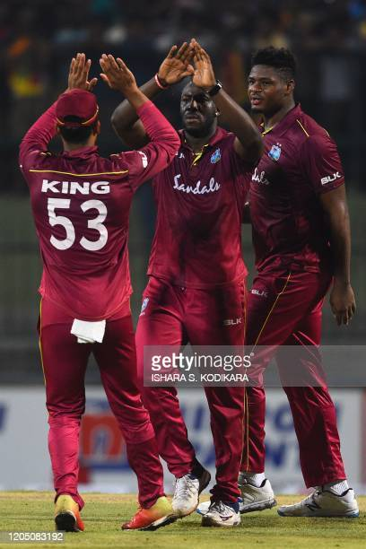 West Indies' Andre Russell celebrates with his teammates after dismissing Sri Lanka's Kusal Perera during the first Twenty20 international cricket...
