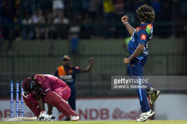 West Indies' Andre Russell is bowled out by Sri Lanka's captain Lasith Malinga during the first Twenty20 international cricket match of a twomatch...