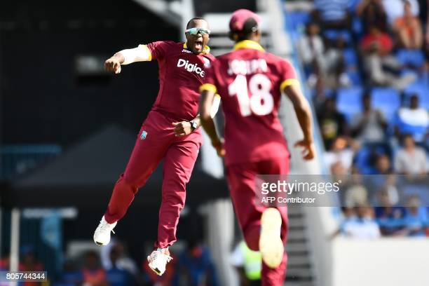 West Indies' Ashley Nurse leaps into the air to celebrate after dismissing India's Kedar Jadhav during the fourth One Day International match between...