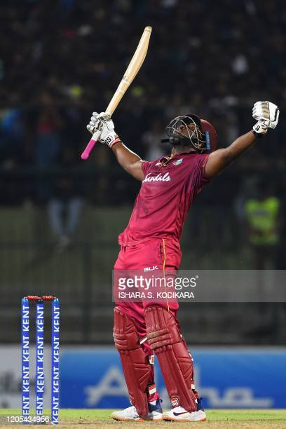 West Indies' batsman Andre Russell celebrates after scoring the winning run to defeat Sri Lanka by seven wickets during the second Twenty20...