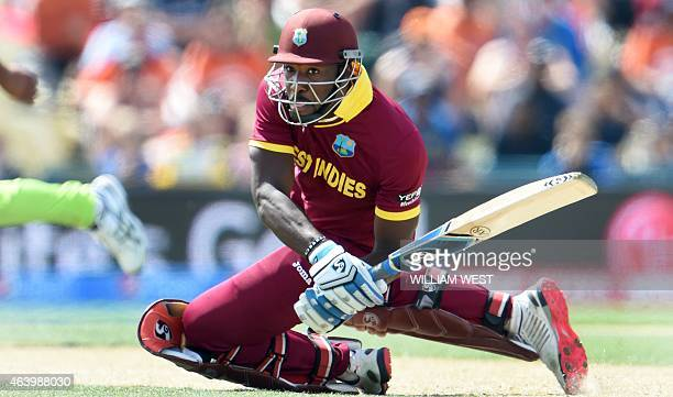 West Indies batsman Andre Russell falls to the ground as he plays a shot from the Pakistan bowling during their 2015 Cricket World Cup Group B match...