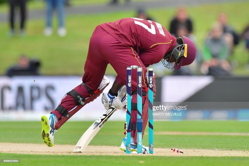 West Indies batsman Chadwick Walton is bowled out during the third one-day international (ODI) cricket match between New Zealand and the West Indies at Hagley Oval in Christchurch on December 26, 2017. / AFP PHOTO / Marty MELVILLE